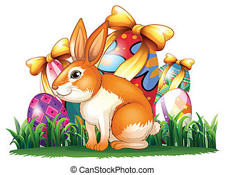 A cute bunny in front of the Easter eggs