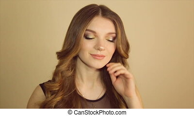 A cute girl smiling posing at the camera