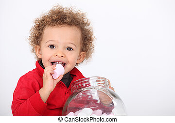 A cute kid eating marshmallow