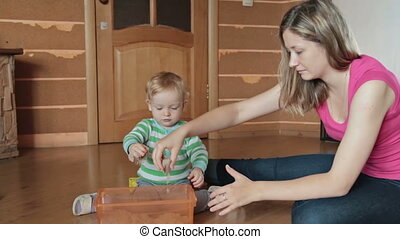 A cute little blond boy play with kinetic sand - A cute...
