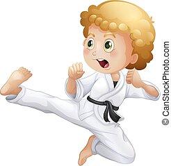 A cute little boy doing karate