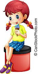 A cute little girl eating icecream
