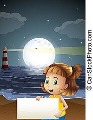 A cute little girl holding an empty signboard at the beach