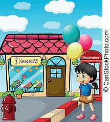 A cute little girl holding balloons
