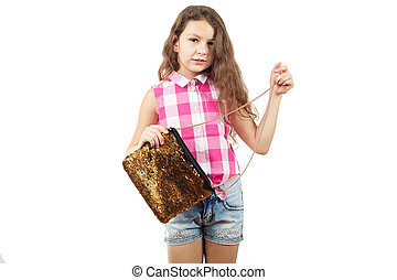 A cute little girl posing in a sleeveless shirt with a bag