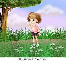 A cute little girl walking in the street