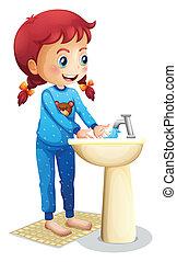 A cute little girl washing her face
