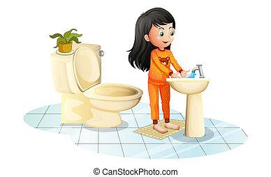 A cute little girl washing her hands