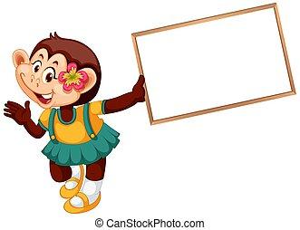 A cute monkey holding blank banner