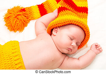 A cute newborn little baby girl sleeping