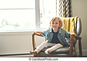 Cute two years old child sit on chair - A Cute two years old...