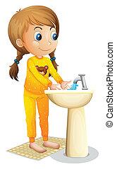 A cute young girl washing her hands