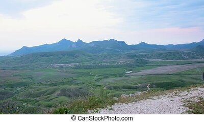 A cyclist travels across mountain Crimea