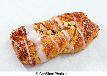 A Danish pastry twist on white dish.