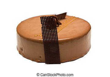 Dark chocolate cake on white background.