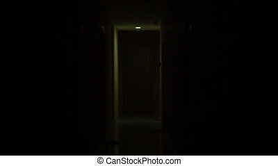 dark terrible corridor with a flickering lamp
