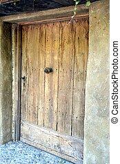 A dark wooden door.