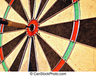 bullseye - a dart in the bullseye position of a dartboard...