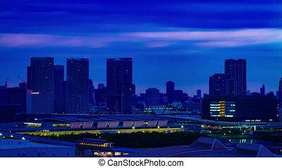 A dawn timelapse at the urban city street in Ariake Tokyo high angle long shot