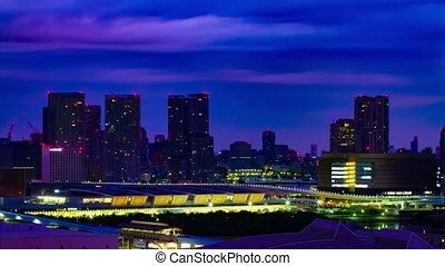 A dawn timelapse at the urban city street in Ariake Tokyo high angle long shot tilt