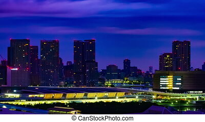 A dawn timelapse at the urban city street in Ariake Tokyo high angle long shot zoom