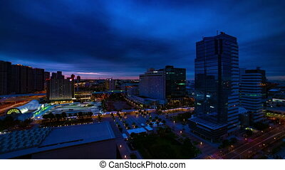 A dawn timelapse at the urban city street in Ariake Tokyo high angle wide shot