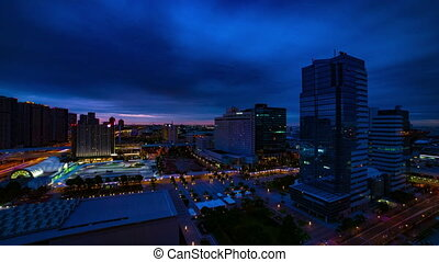 A dawn timelapse at the urban city street in Ariake Tokyo high angle wide shot tilt
