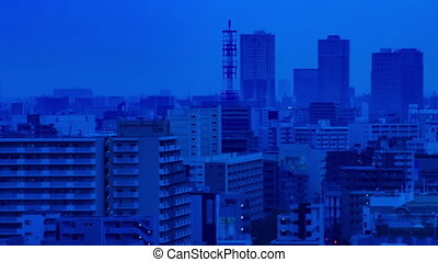 A dawn timelapse at the urban city street in Tokyo high angle long shot panning