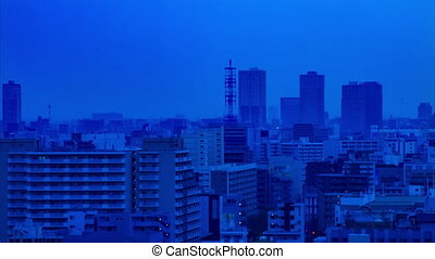 A dawn timelapse at the urban city street in Tokyo high angle long shot tilt