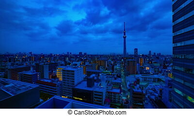 A dawn timelapse at the urban city street in Tokyo high angle wide shot