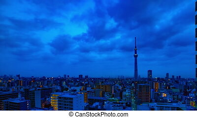 A dawn timelapse at the urban city street in Tokyo high angle wide shot panning