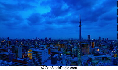 A dawn timelapse at the urban city street in Tokyo high angle wide shot zoom