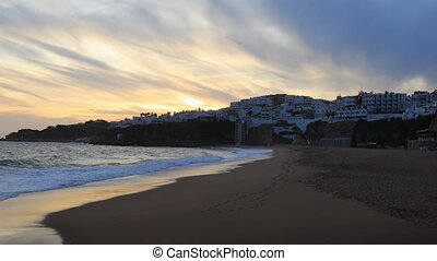 Day to night timelapse of the beach at Albufeira, Portugal -...