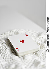 deck of poker cards with the ace of hearts on top