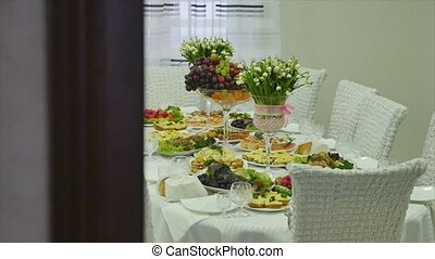 A decorated dining table flowers