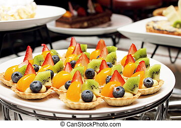 Delicious cakes with mixed fresh fruit
