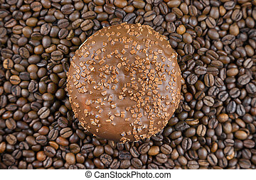 A delicious donut with chocolate and whole coffee grains ...