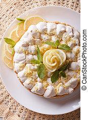 lemon meringue pie close-up on a plate. vertical top view