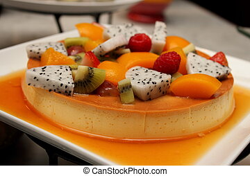 a Deliciuos caramel custard close shot with fresh fruit