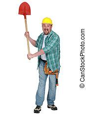 A delirious tradesman holding up a spade