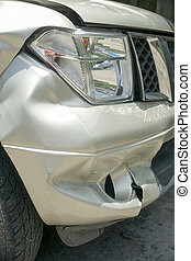 A dent on the right front of a pickup truck (damage from crash a