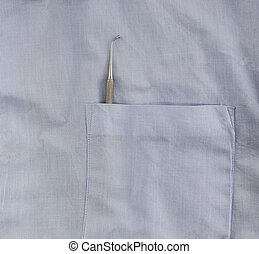 a dentist with dental instrument in the pocket of the blue lab coat