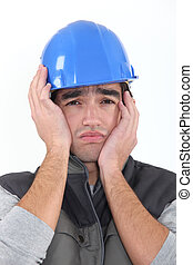 A depressed construction worker.
