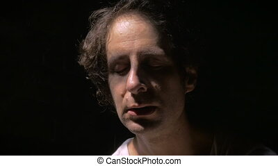 A depressed man hides in the shadows from himself - A...