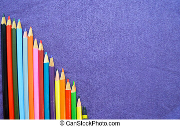 A descending chart of colorful, bright, variegated drawing pencils and space for text on a purple background.