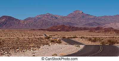 A desert road in the mountains