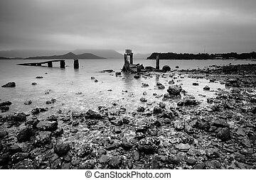 a desolate and broken peer on the beach