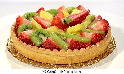 A dessert. Fruit tart on white plat - Fruit tart rotating....