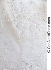 A detailed picture  the wedding dress closeup
