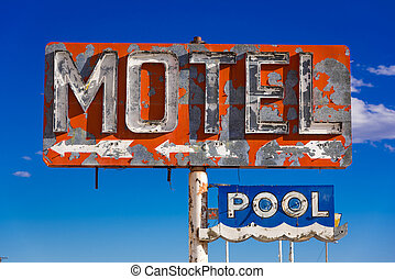 A dilapidated, vintage motel sign in the desert of Arizona